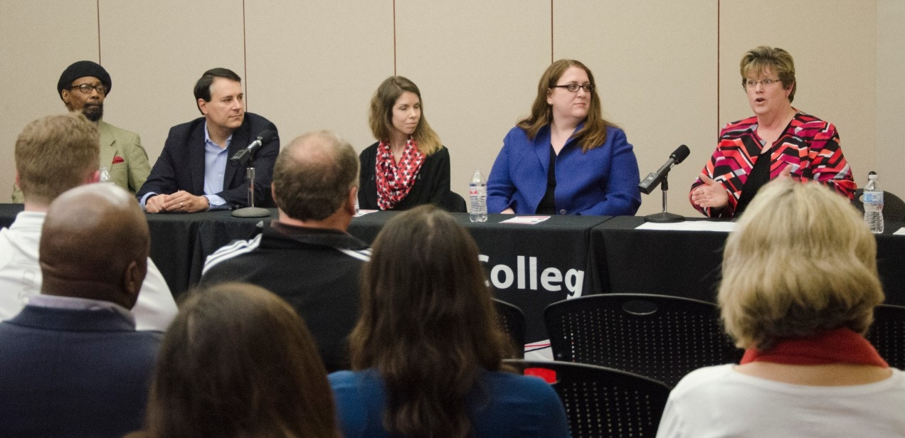 Alumni answering questions at UC Blue Ash College