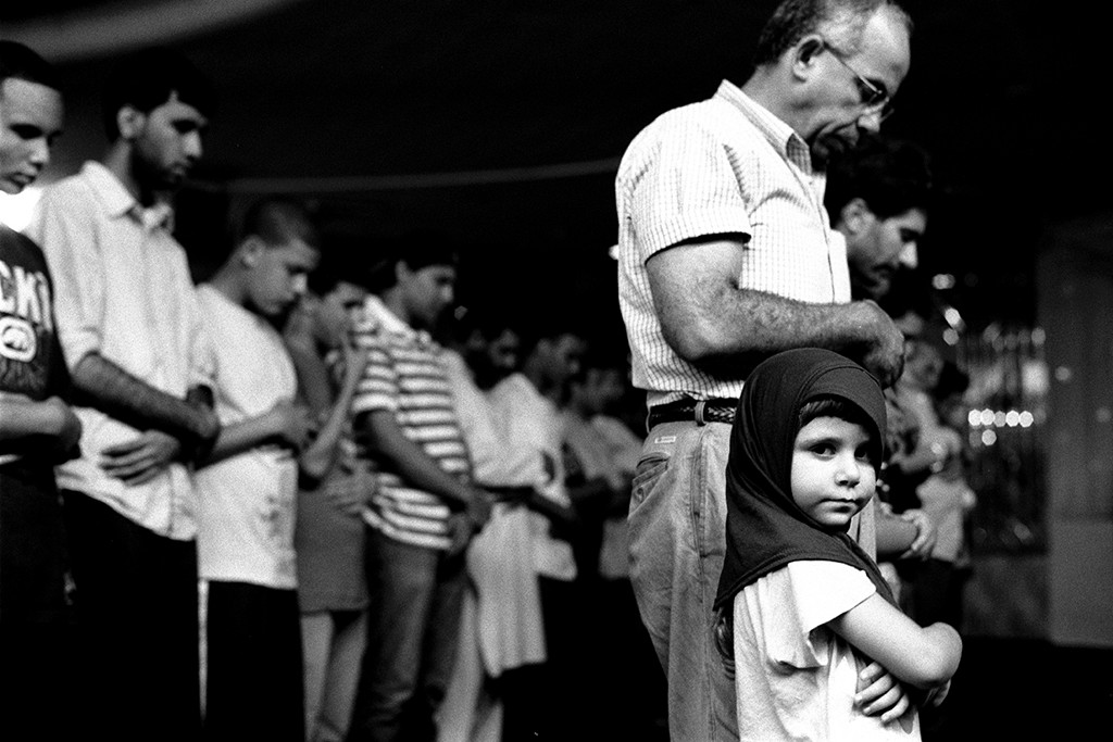 "1. Young Girl at Prayers with Her Father, Muslim American Society, Brooklyn NY,  gelatin silver photograph, 16""x20"" (2010)"