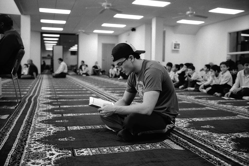 "6. Student Reading Qur'an, Islamic Society of Wichita, Wichita, KS, gelatin silver photograph, 16""x20"" (2011)"