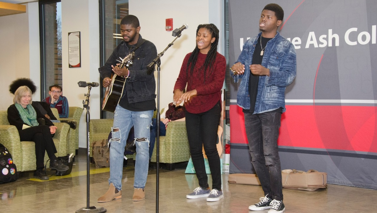 Students preforming a song at a Poetry Café event