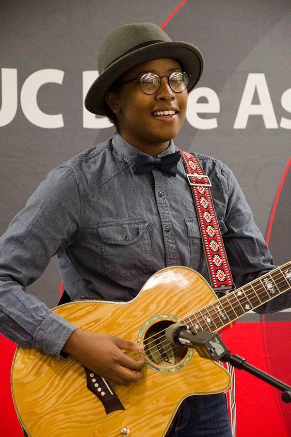 Hawa Tarawally playing a guitar