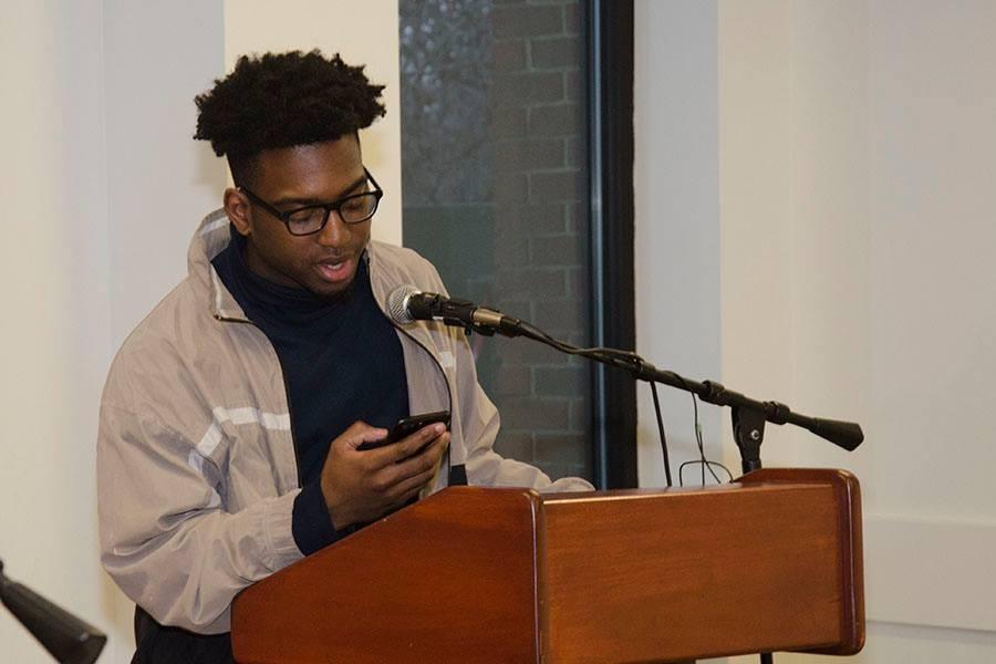 Corey Jackson reading a poem