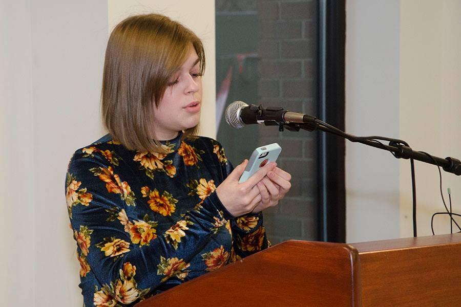 Elise Loux reads a poem
