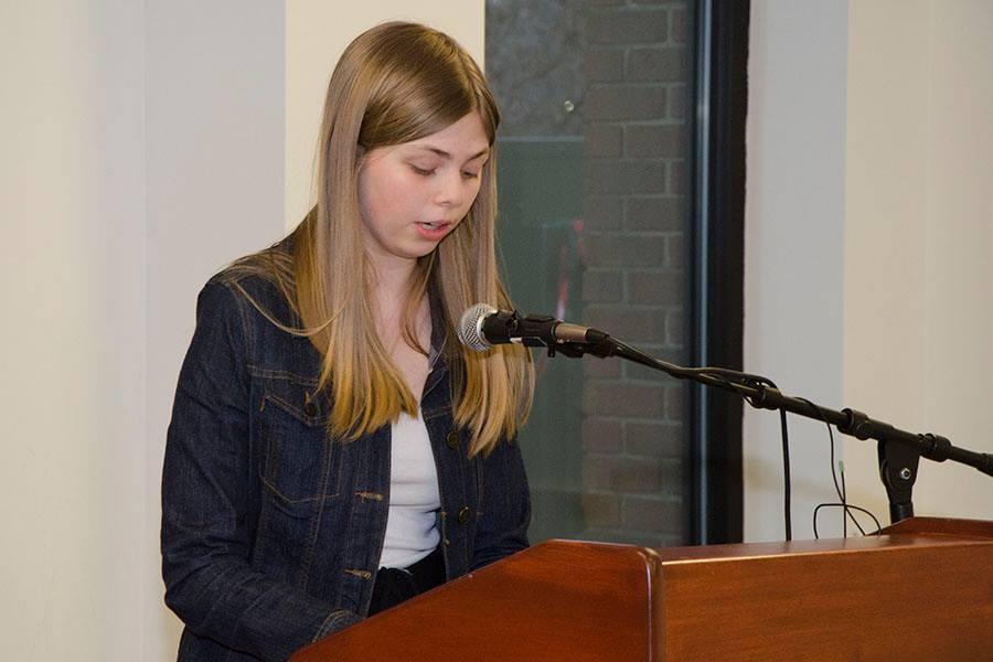 Kay Kemp reading a poem