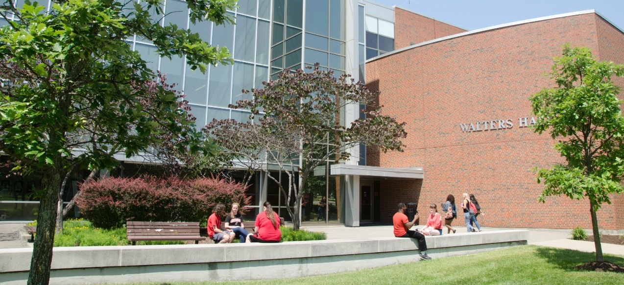 Students sitting outside of Walters Hall