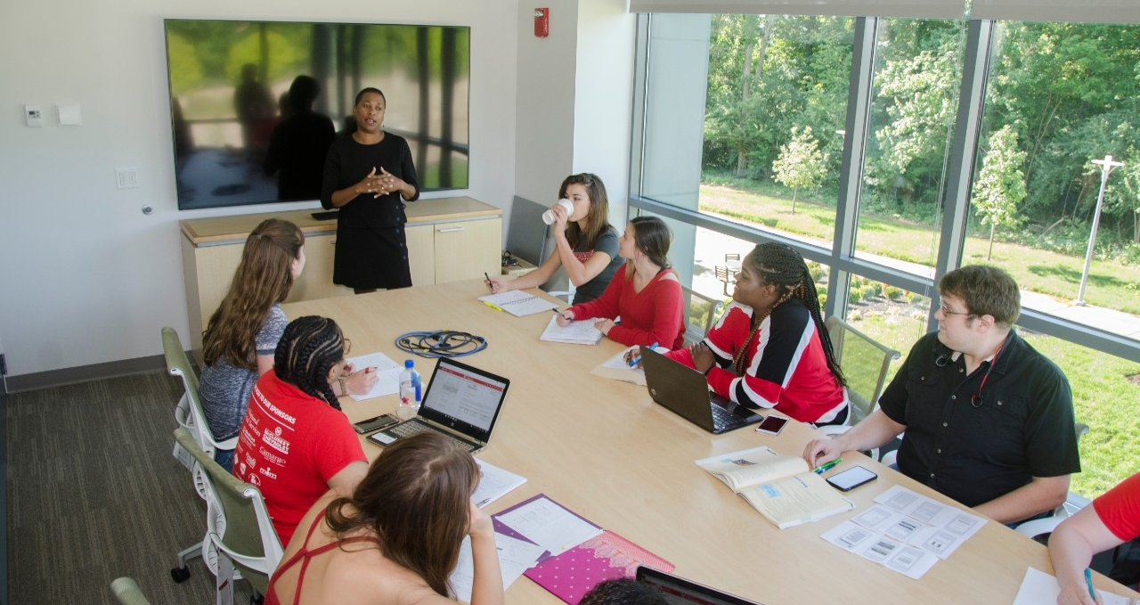 Students listening to professor in a classroom setting