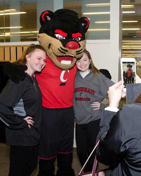 Bearcat mascot with students at open house event
