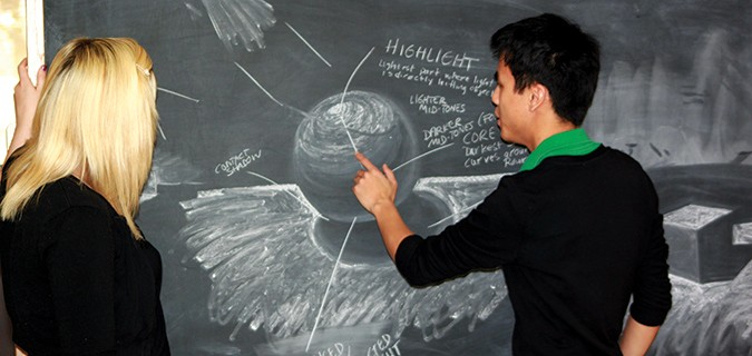 Art and Visual Communication students working with chalkboard