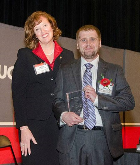 Dean Cady Short-Thompson with Dr. Adam Burkey with award