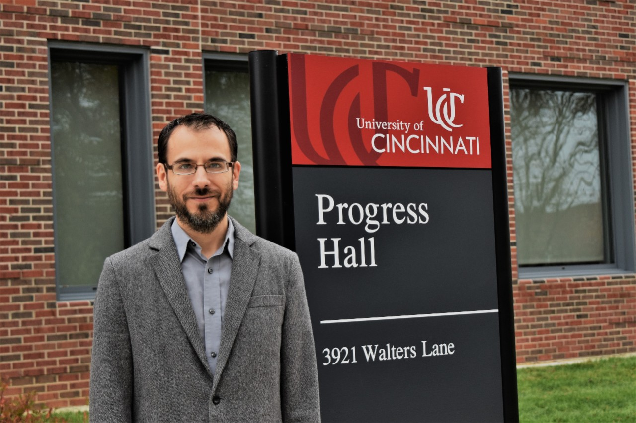 Kevin Oberlin in front of Progress Hall