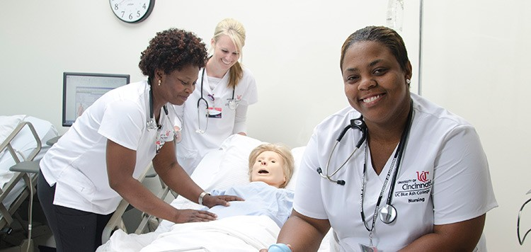 Nursing students working in the lab