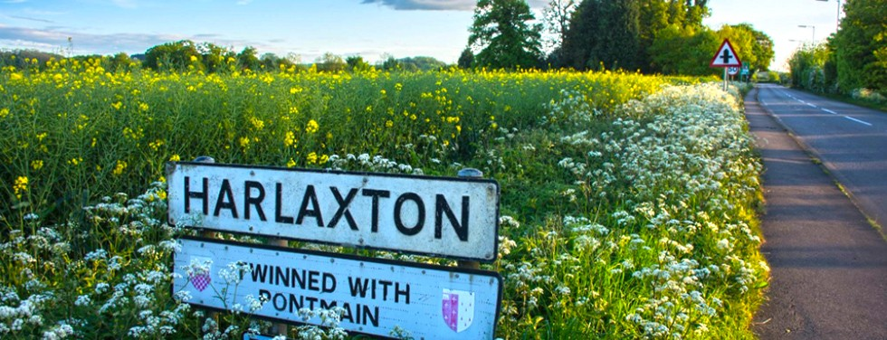 Sign for Harlaxton manor in field