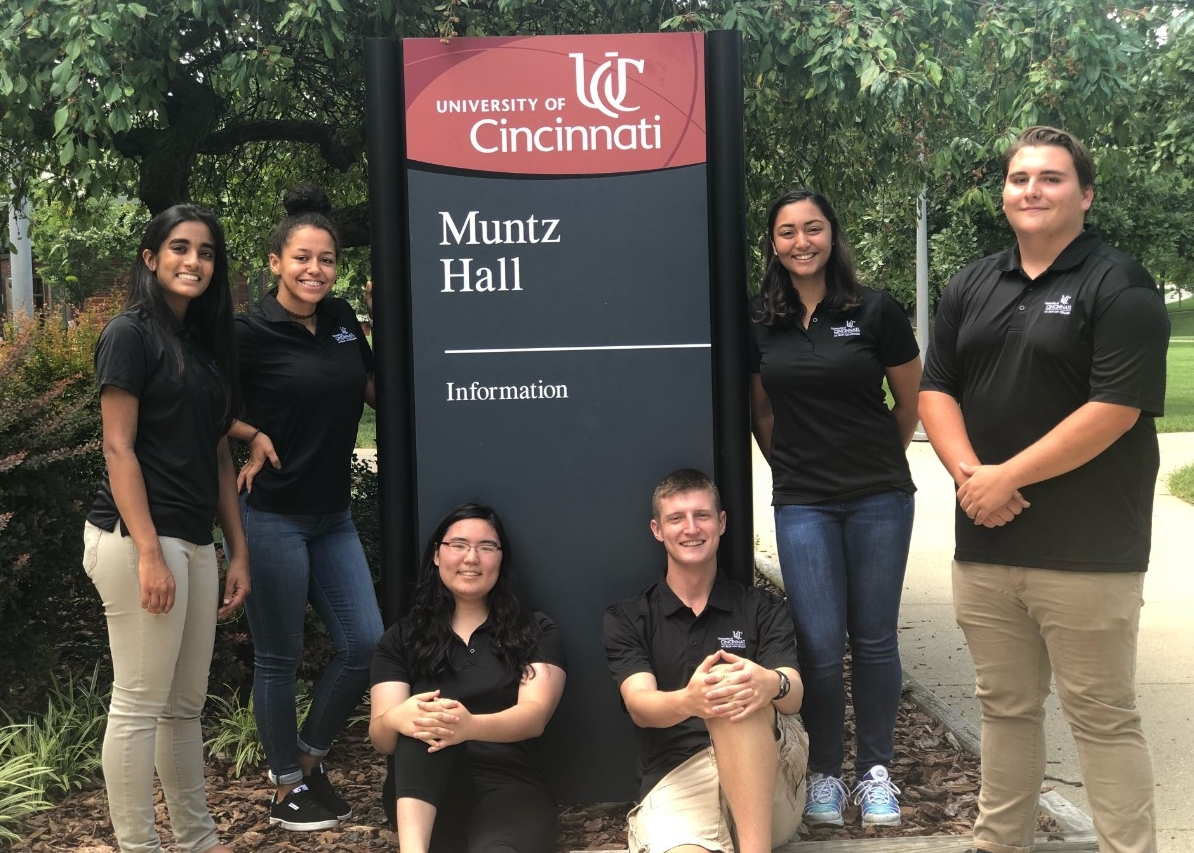 College Credit Plus students in front of Muntz Hall sign