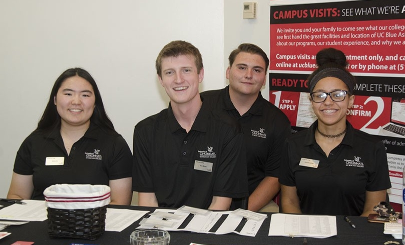 College Credit Plus students working at a welcome table