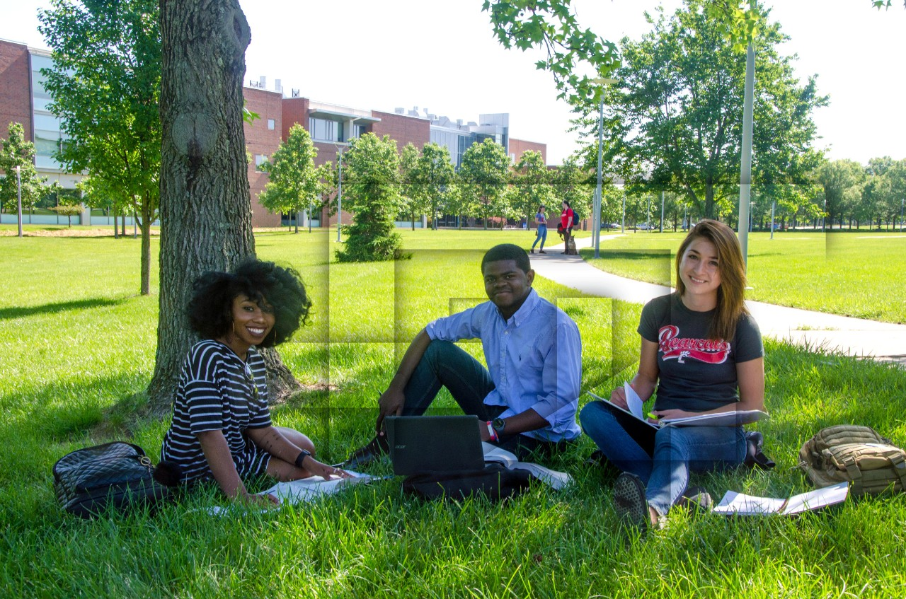 Students sitting outside at UC Blue Ash College